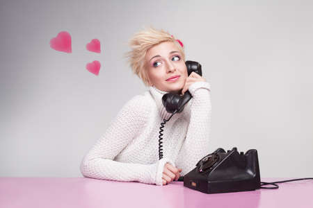 platinum hair: teenage girl in love speaking with her boyfriend on the phone