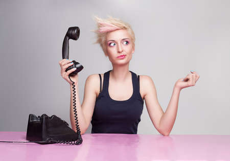 young beautiful lady does not care the phone Stock Photo - 18618114