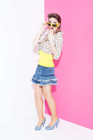 ratty: 80s style young beautiful fashion model surprised on pink and white background Stock Photo