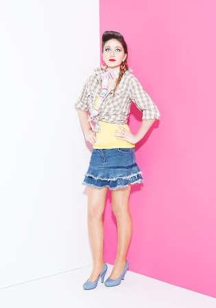 ratty: young lady in colorful clothes posing on white and purple background