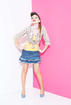 ratty: beautiful lady with 80s style colorful clothes smiling and posing on pink white background