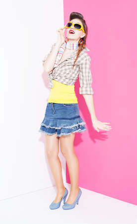 ratty: surprised young model from 80s posing on pink and white background