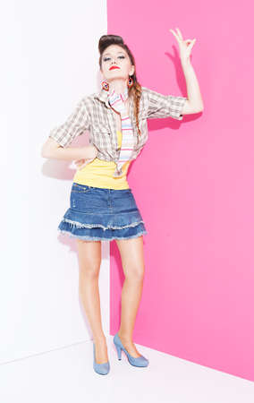 ratty: young lady from 80s making a victory symbol with her fingers on pink white background