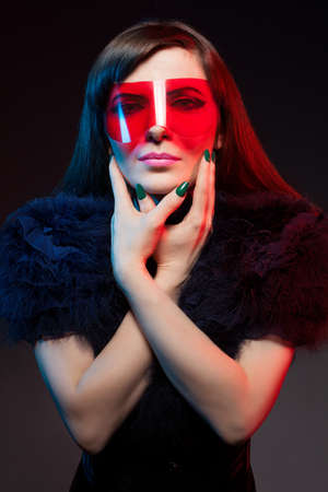 colorful fashion portrait of a young model on dark background photo