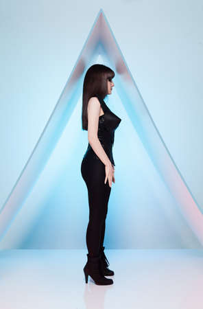 full strenght: profile of a model with a futuristic clothes on blue background