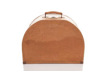 old used beige suitcase isolated on white background photo