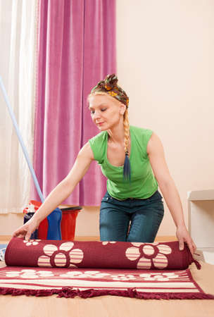 beautiful young cute lady cleaning the house photo