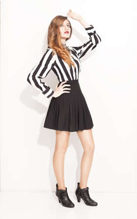beautiful fashion model posing on white background photo