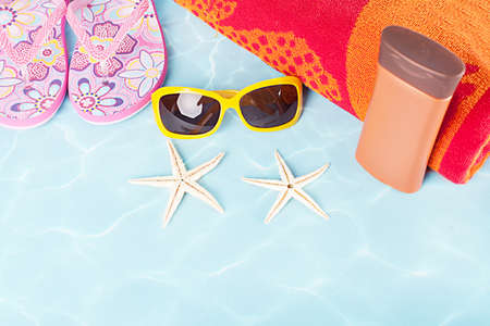 stuff: various colorful beach stuff on blue background Stock Photo