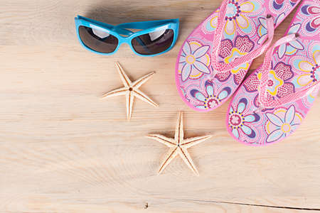 stuff: various colorful beach stuff on wooden background background