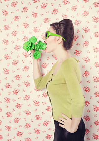 vegeterian: vegeterian lady eating green roses in front of retro wall background