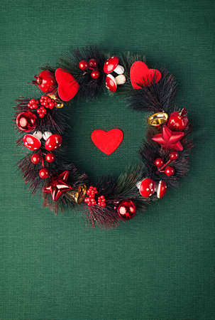beautiful evergreen christmas wreath on green background photo