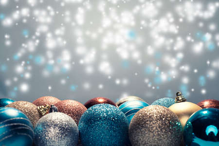close up of various christmas balls on blue background