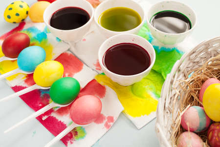 creative egg painting: easter preparation with colorful dyes and egss Stock Photo