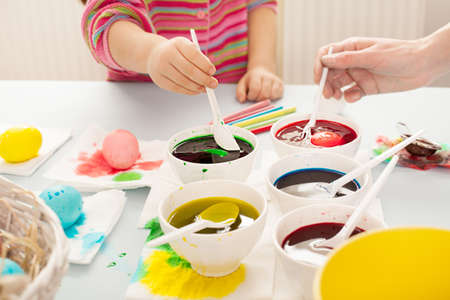 easter preparation with colorful dyes and egss Stock Photo