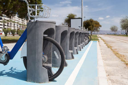 rack wheel: bicycle parking rack in the urban environment Stock Photo