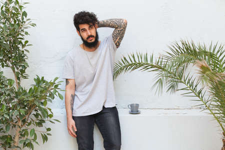 arm tattoo: stylish hipster guy with a tattooed arm