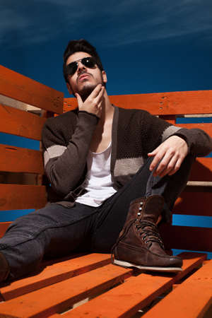 hansome: hansome young guy sitting and posing in casual clothes Stock Photo