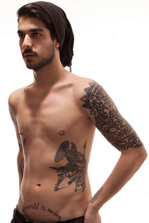 hipster style young man with several tattoos posing topless photo