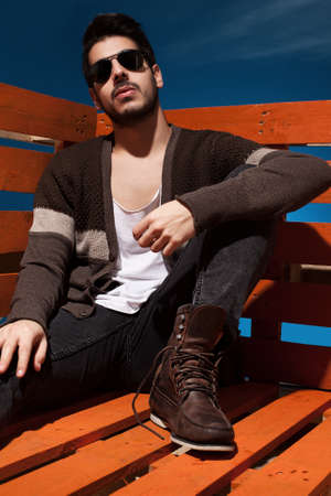 hansome young guy sitting and posing in casual clothes Stock Photo