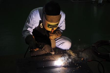 Men to arc welding Stock Photo