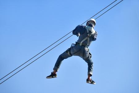 Men enjoy the zip line