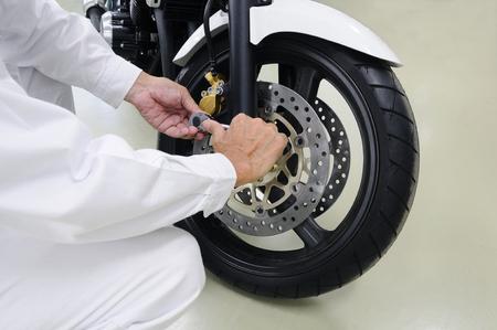 オートバイのメンテナンス 写真素材