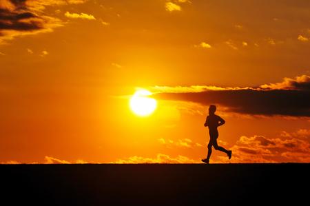 夕日の男性 写真素材