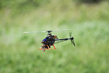 Test flight of radio control helicopter