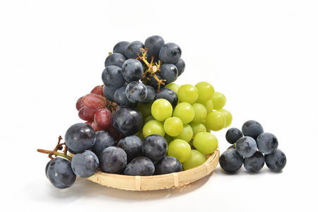 Grape in a basket on white background