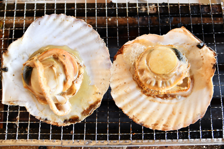 Barbecued scallops Imagens