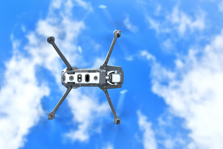 Drone fly in the blue sky background