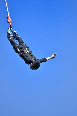 Men Bungee Jumping