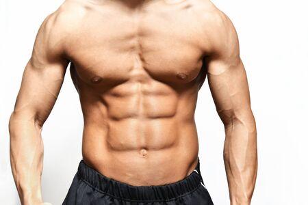 Het lichaam van een getrainde jonge man Stockfoto