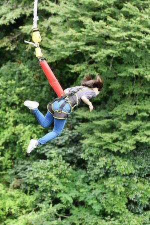 A woman jumping bungee