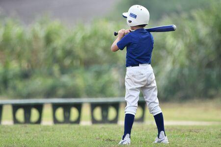 a boy pretending to be a baseball player
