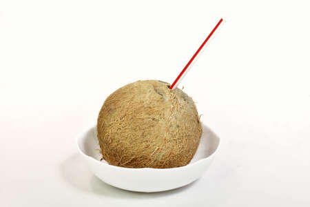 coconut with a straw