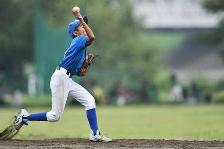 a pitcher in a juvenile baseball game