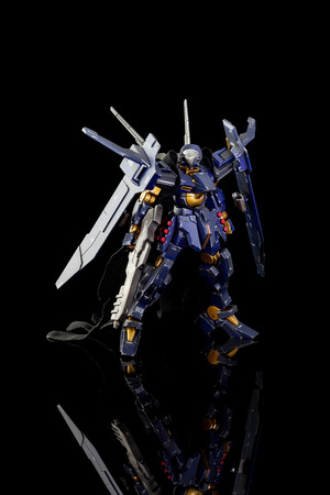 panoply: CHIANG MAI, THAILAND - JUL 10, 2016: Plastic model of Gundam from the Gundam series of Animated TV shows. The model is posed on a black background and is manufactured by Bandai