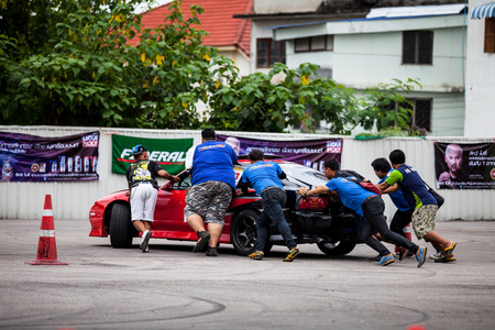 drifting: CHIANGMAI, THAILAND - JUL 04 2016: An unidentified driver performs a drifting competition in the NRT Gymkhana Thailand Editorial