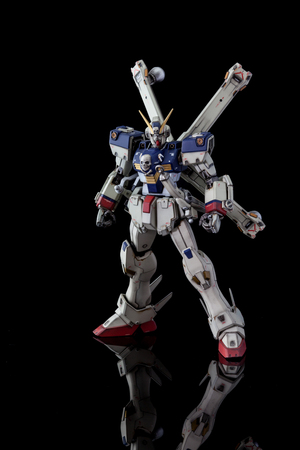 CHIANG MAI, THAILAND - JUL 10, 2016: Plastic model of Gundam from the Gundam series of Animated TV shows. The model is posed on a black background and is manufactured by Bandai