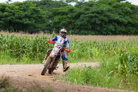CHIANG MAI, THAILAND - OCT 2: Unknown Motorcycle driver piloting his Motocross on the tracks, Oct 2, 2016 in Chiang Mai, Thailand.