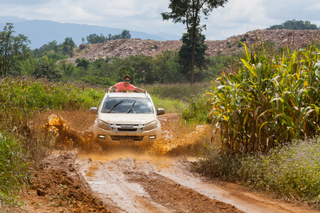 piloting: CHIANG MAI, THAILAND - OCT 2: Unknown car driver piloting his car on the tracks, Oct 2, 2016 in Chiang Mai, Thailand. Editorial