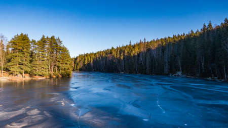 View of a frozen lake in the middle of a Scandinavian forest, Noraway