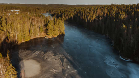 Aerial view of a frozen lake in the middle of a Scandinavian forest, Norway