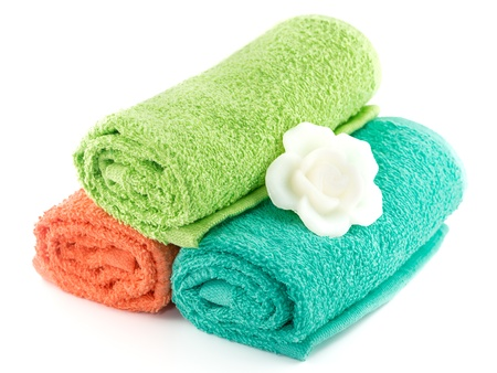 Colorful towels  and soap isolated on white background photo