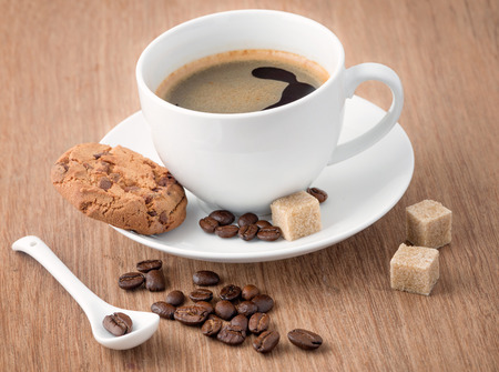 Cup of coffee and cookie photo