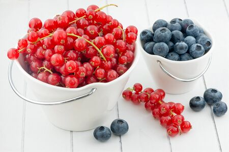 redcurrant: Wild berries in bowls - blueberry, redcurrant