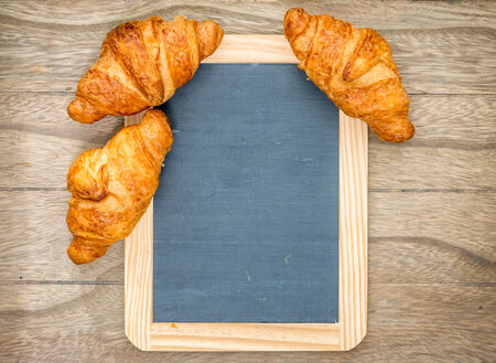 traditionally french: Fresh baked croissants on wooden table Stock Photo