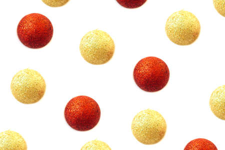 Glitter golden and red balls Christmas pattern isolated on white background. Festive background.